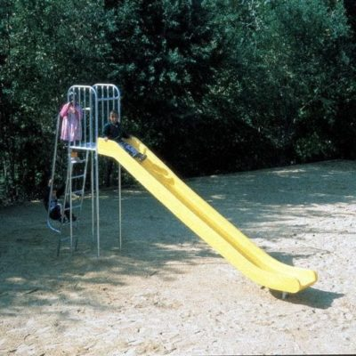 Tall slide in yellow at a playground with three children sliding down