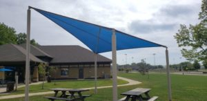 Shade Sail Example in a Park Covering Two Picnic Tables