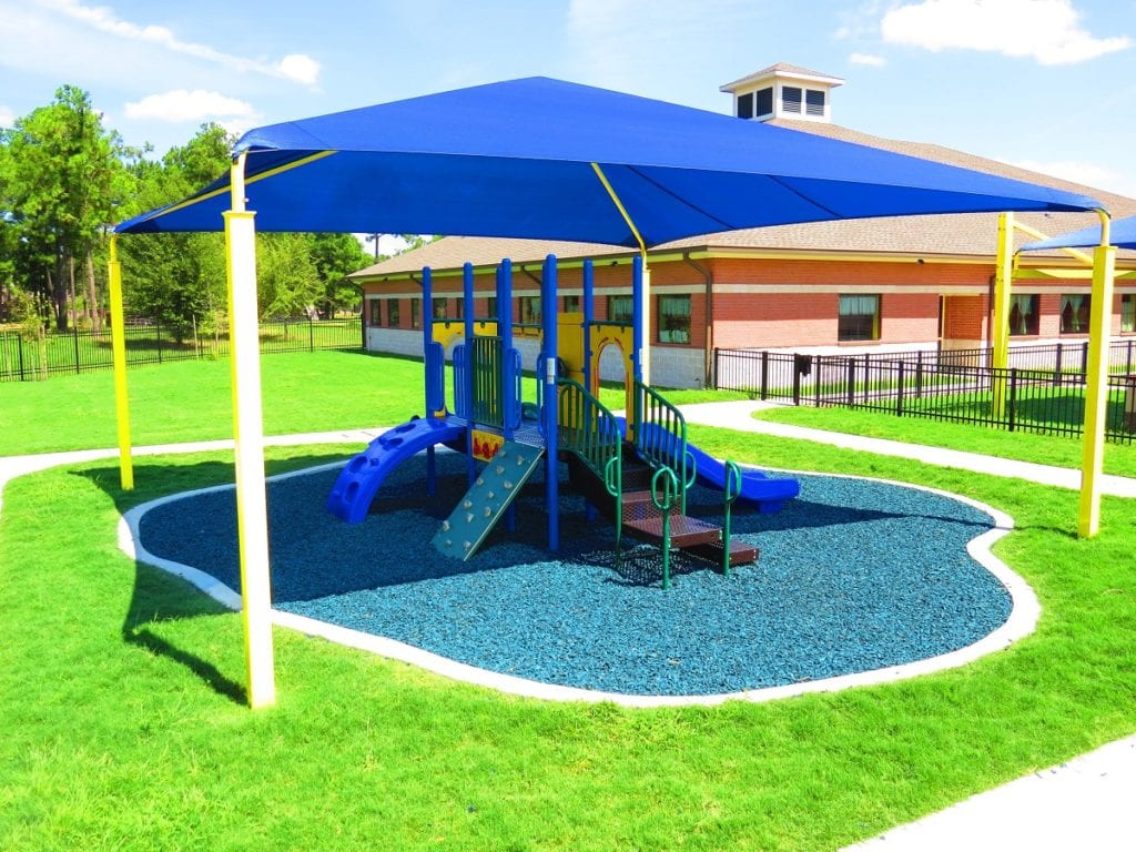 Playground Without Roof Under a Playground Shade Structure with Blue Rubber Mulch Safety Surfacing