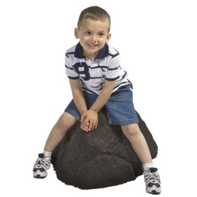 Child sitting on Small Rubber Boulder